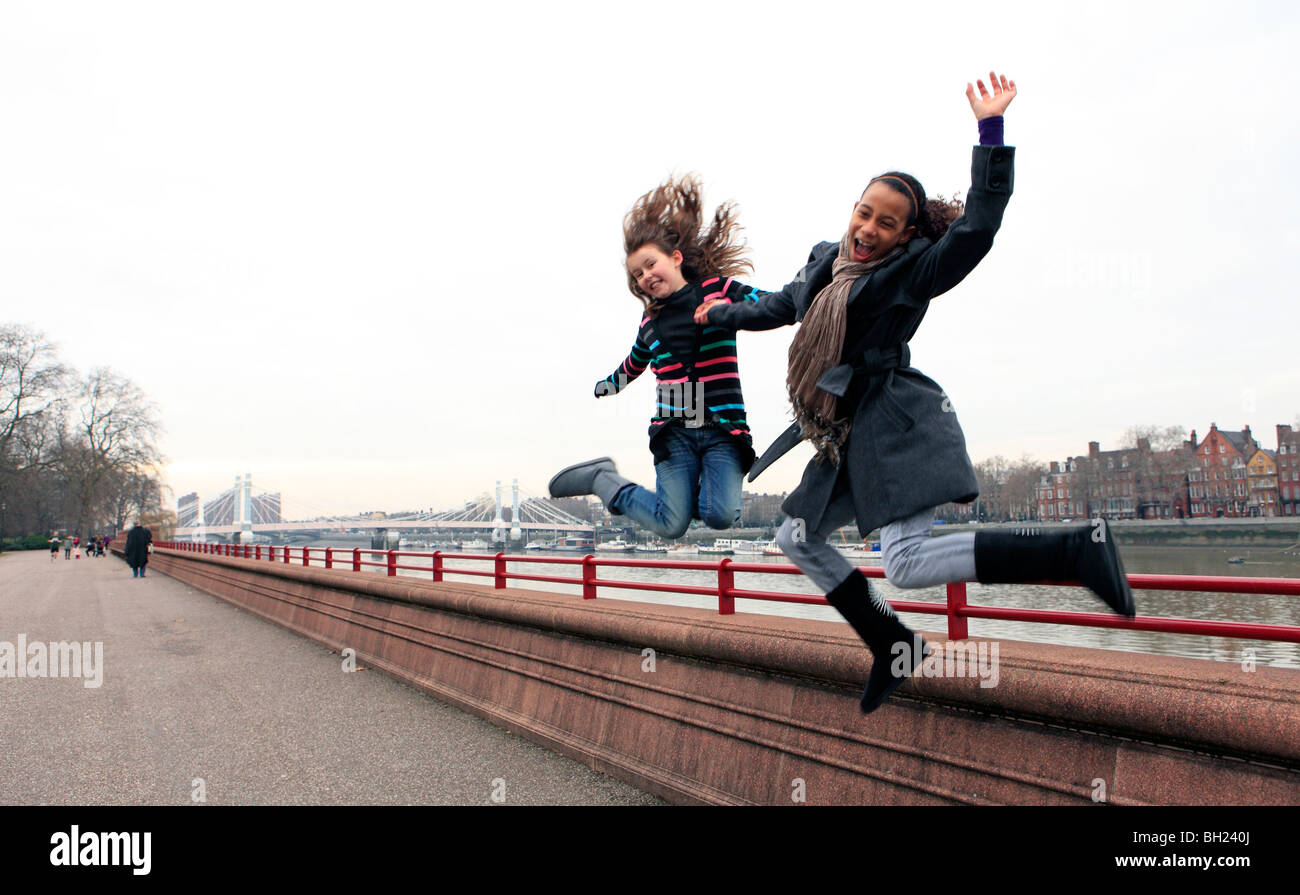 United Kingdom London Battersea Park two teenage girls having fun Photo Stock