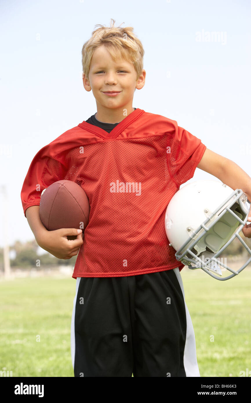 Jeune garçon au football Photo Stock