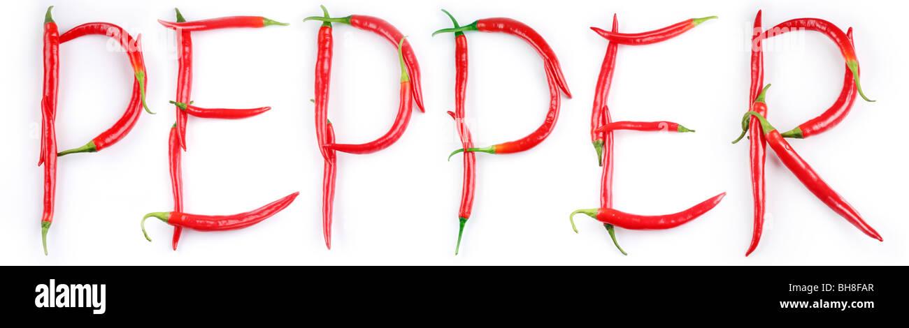 Le mot 'pepper' est écrit sur le livre blanc de chili peppers Photo Stock