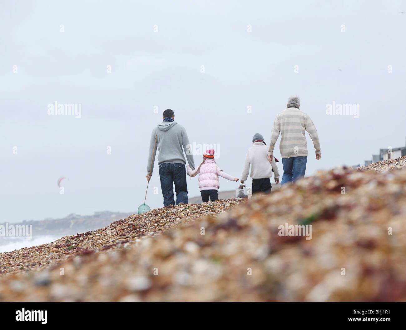 Générations Strolling on Beach Photo Stock