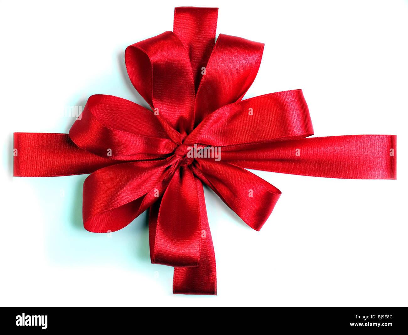 Arc ruban rouge sur fond blanc Photo Stock