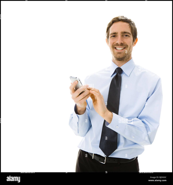 L'homme sur son iPhone Photo Stock