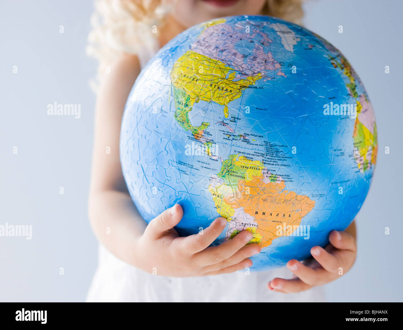 Little girl holding a globe Photo Stock