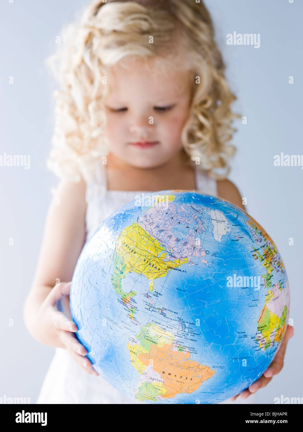 Little girl holding a globe Photo Stock