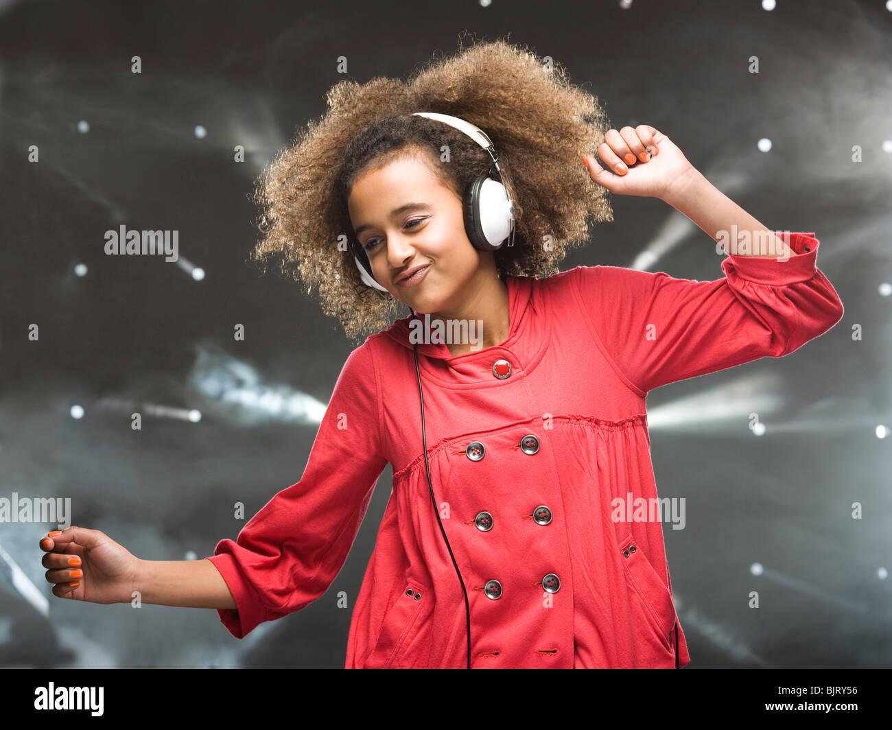 Girl (12-13) Dancing with headphones Photo Stock