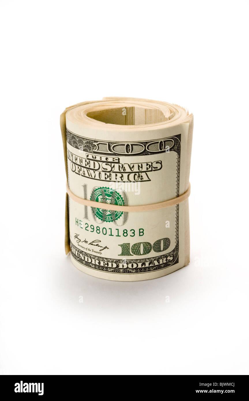 Rouleau de dollar bills on white Banque D'Images