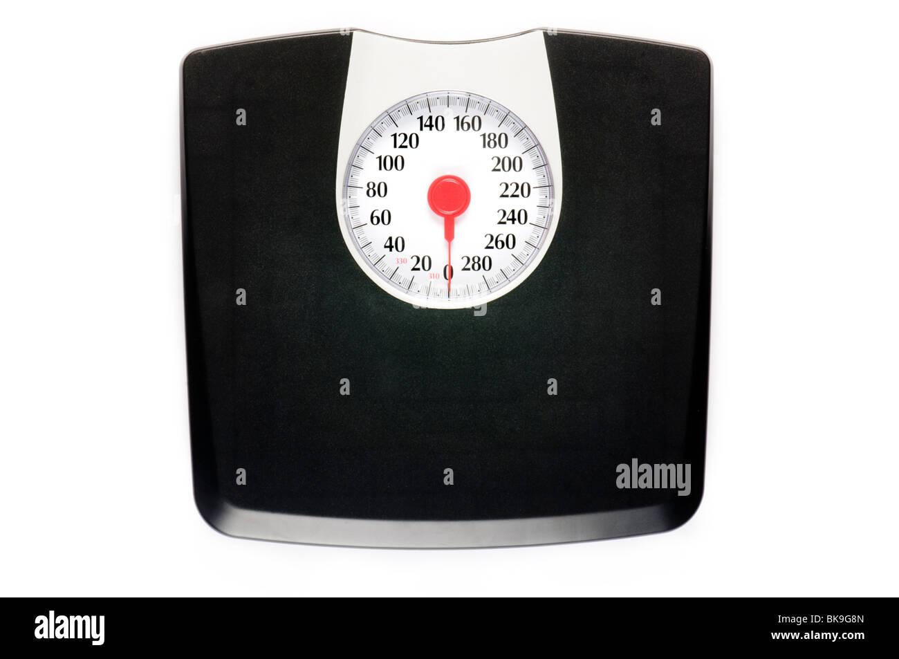 Échelle de poids seul sur la surface blanche Photo Stock