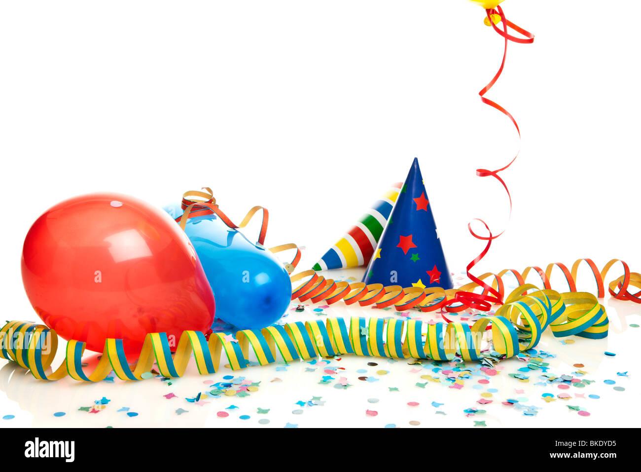 - Partie de la décoration de ballons, chapeaux de fête, banderoles, confetti Photo Stock