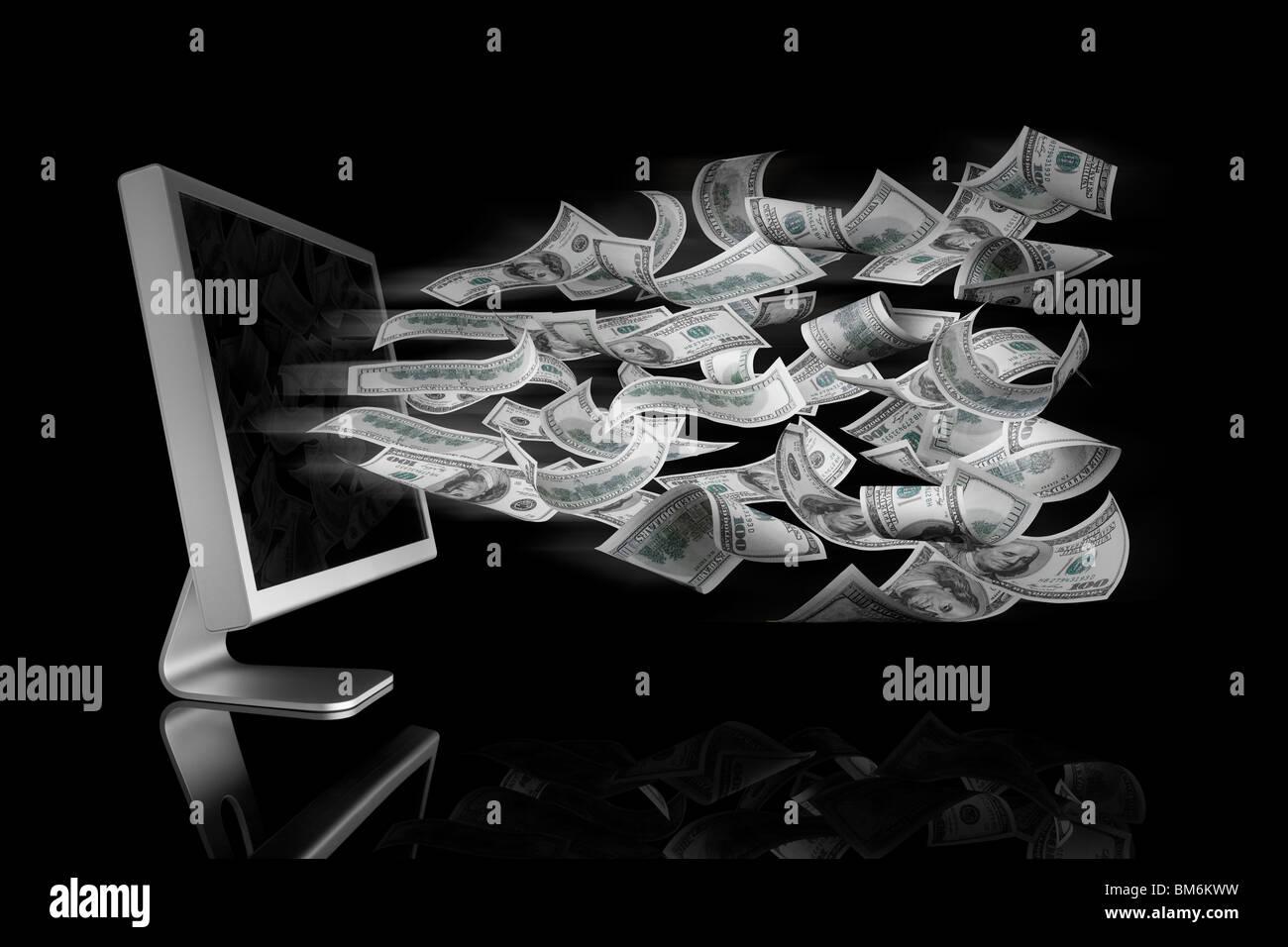 100 Dollar bills qui sortent d'un écran d'ordinateur Photo Stock