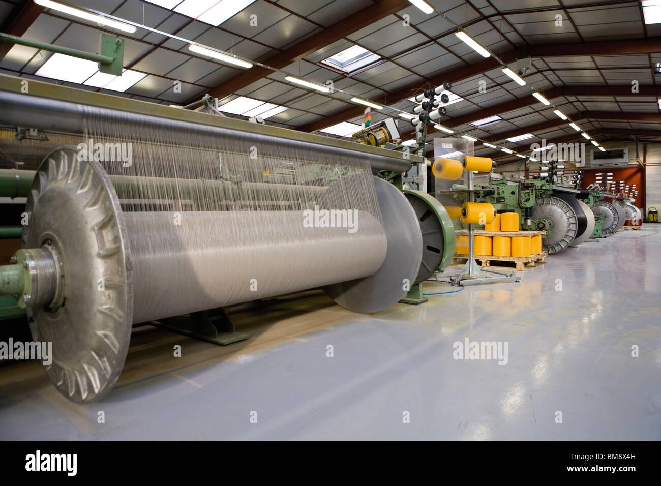 Revêtement en tissu, tissage, ministère de l'usine ensouple et loom Photo Stock