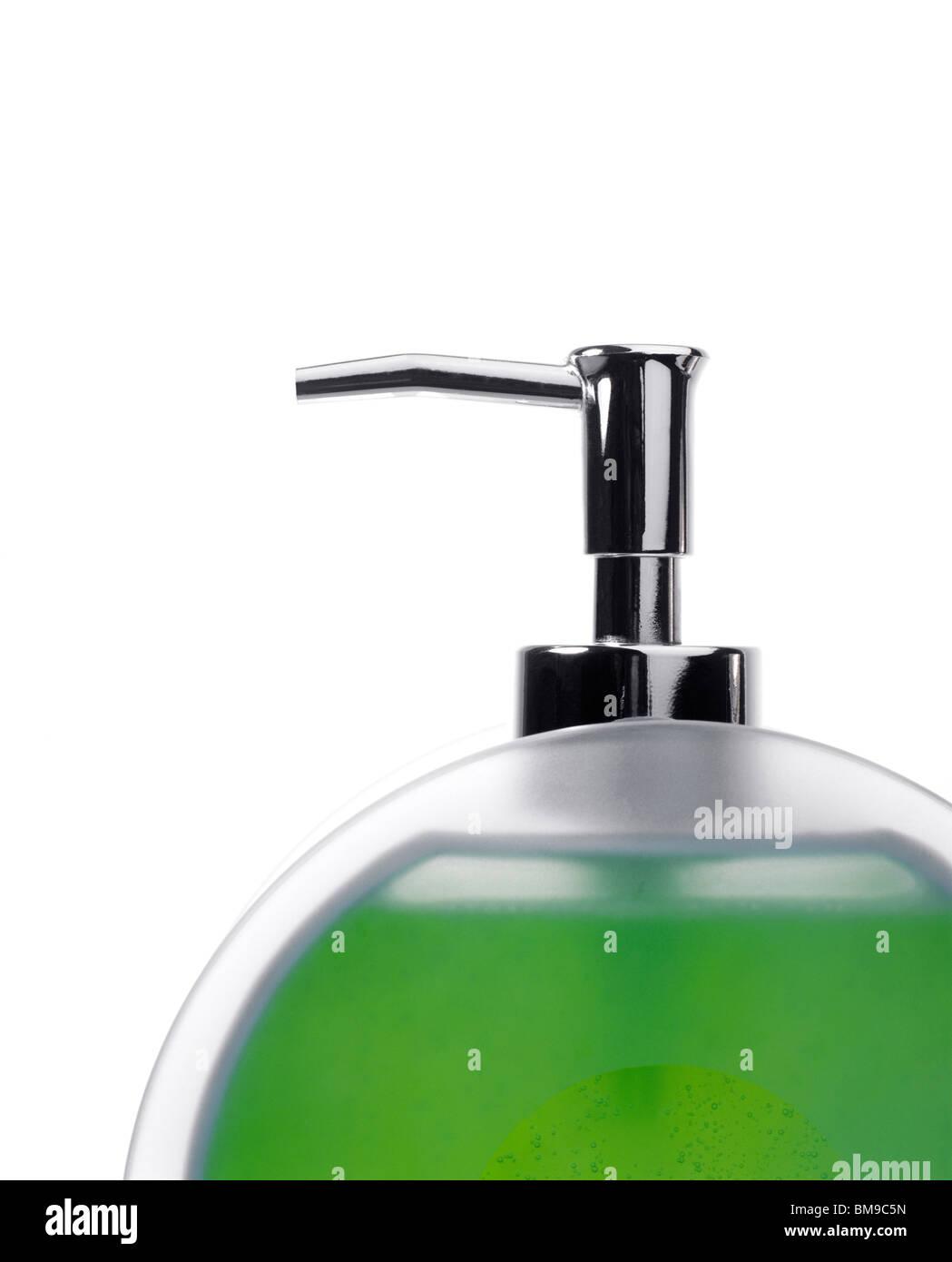 Distributeur de pompe avec du savon liquide vert Photo Stock