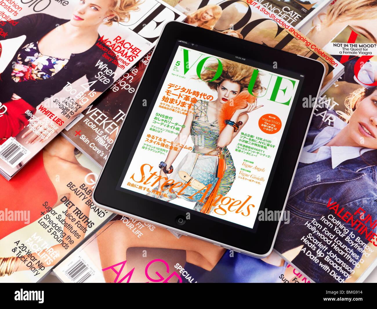 Tablette Apple iPad 3G avec un numéro électronique de vogue sur les magazines de mode imprimé Photo Stock