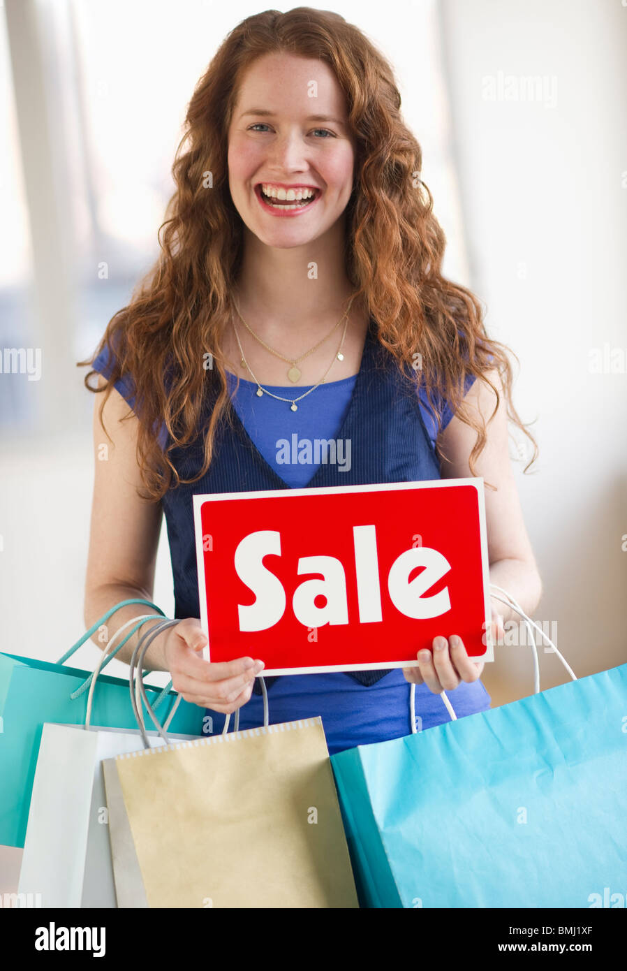 Woman on a shopping spree Photo Stock