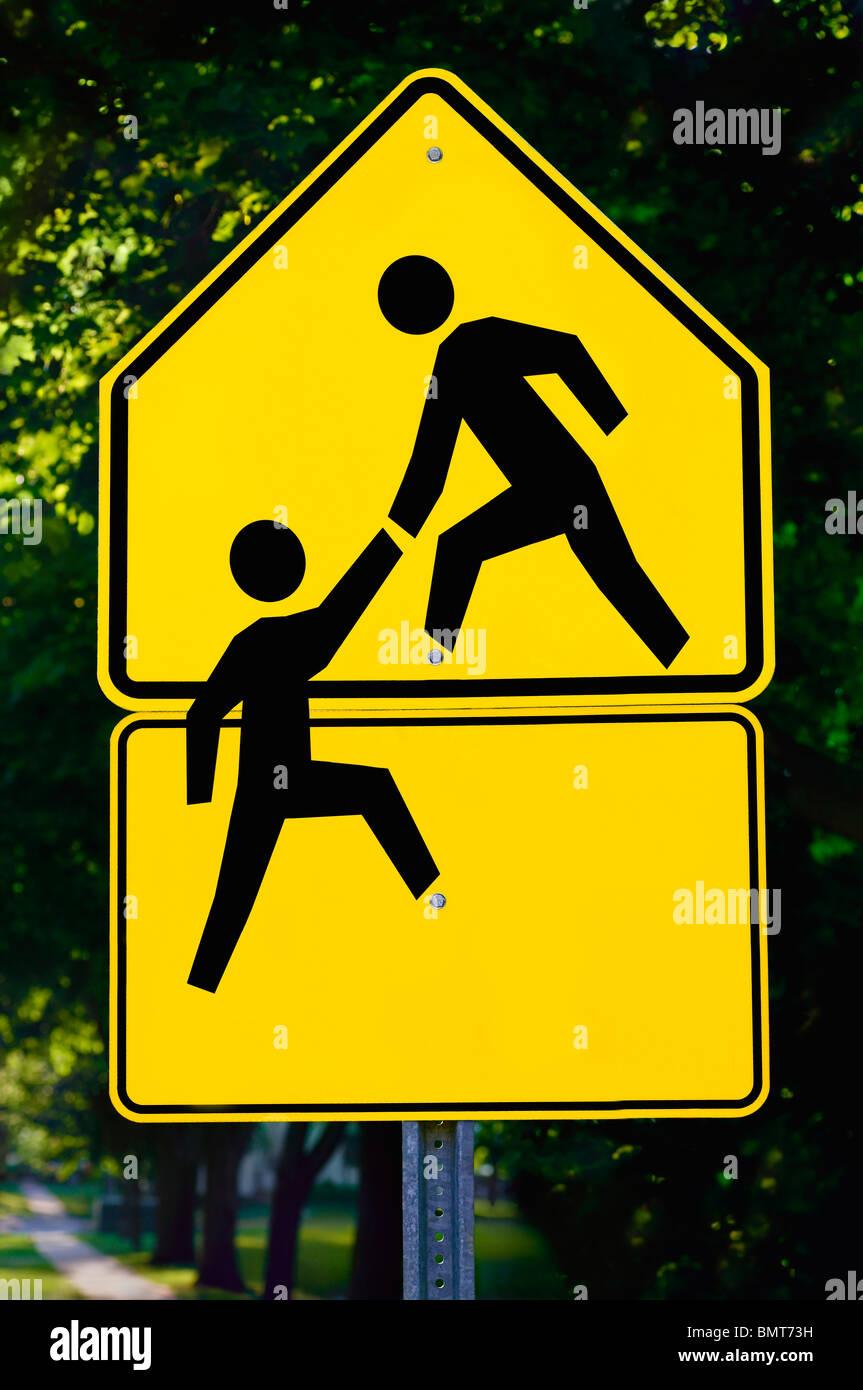 Willmar, Minnesota, United States of America; signe montrant une personne aidant une autre personne Photo Stock