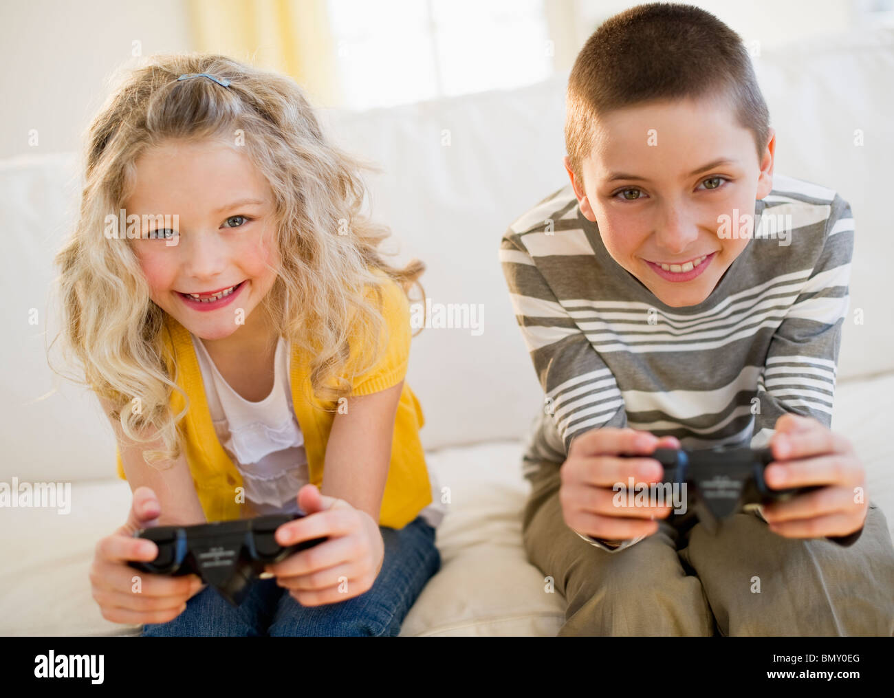 Siblings playing video game Photo Stock
