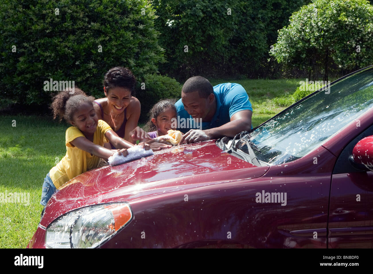 Lavage voiture familiale et de s'amuser Photo Stock