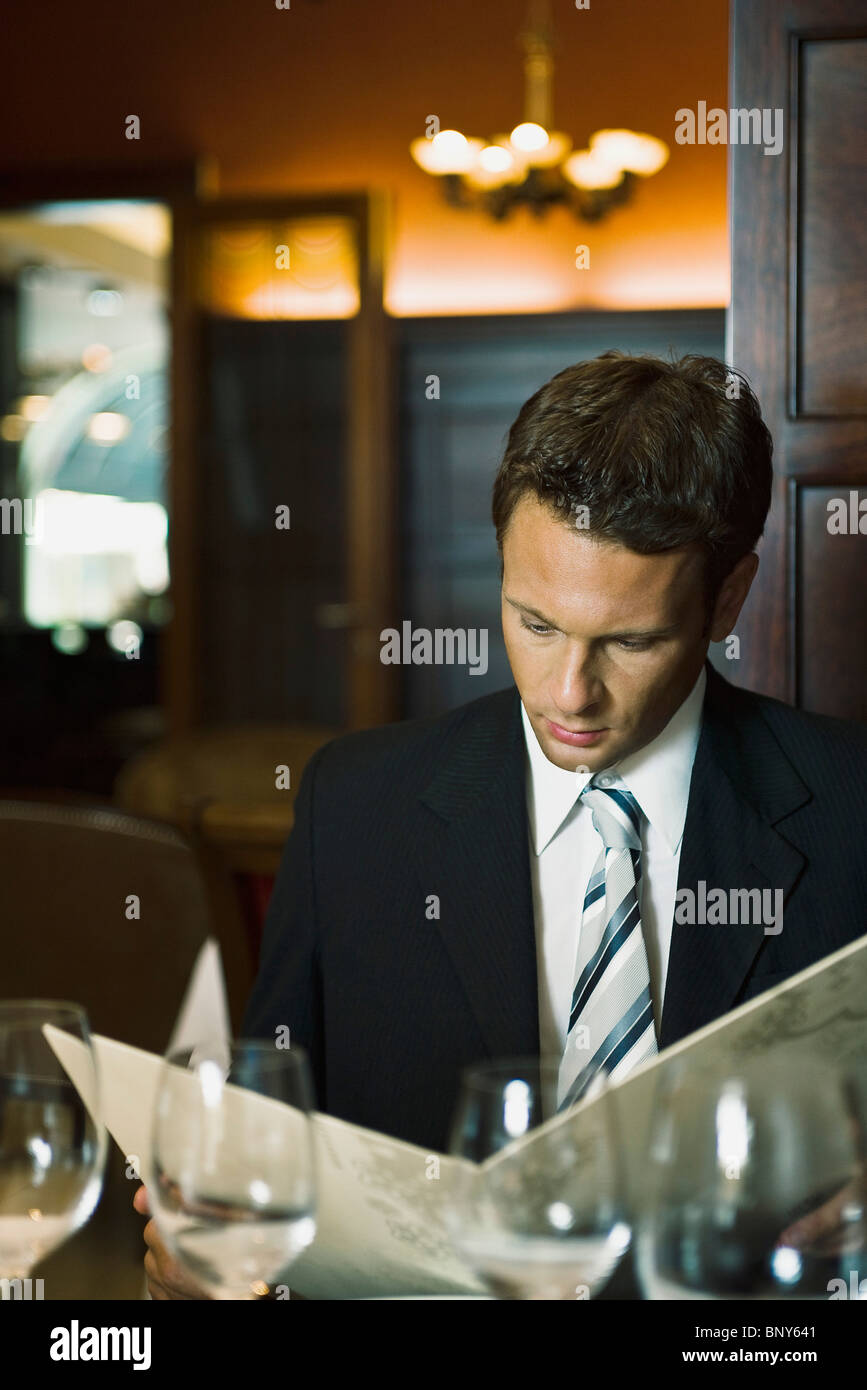 Man in fine menu restaurant Photo Stock