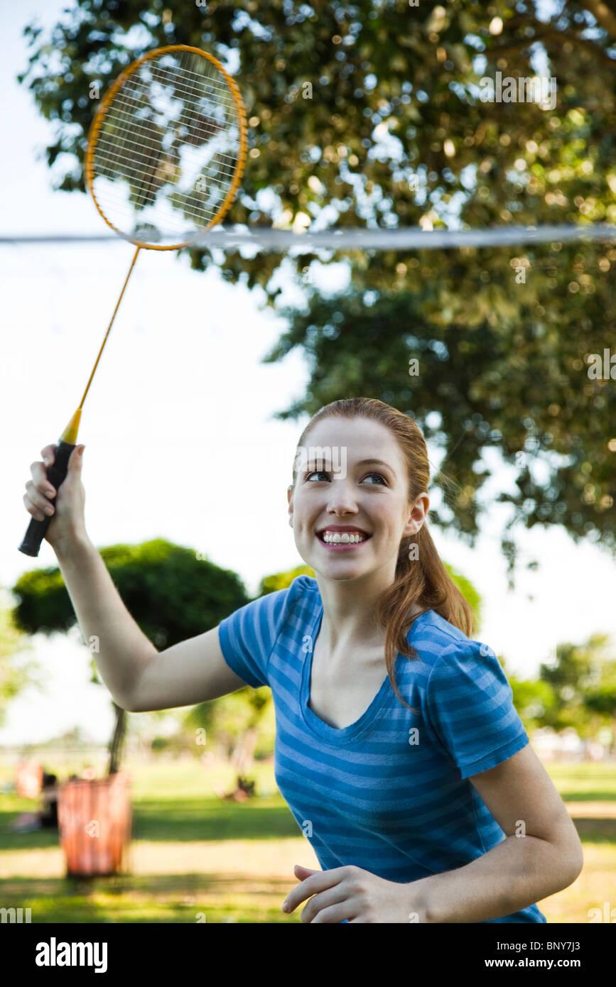 Teen girl playing badminton Photo Stock