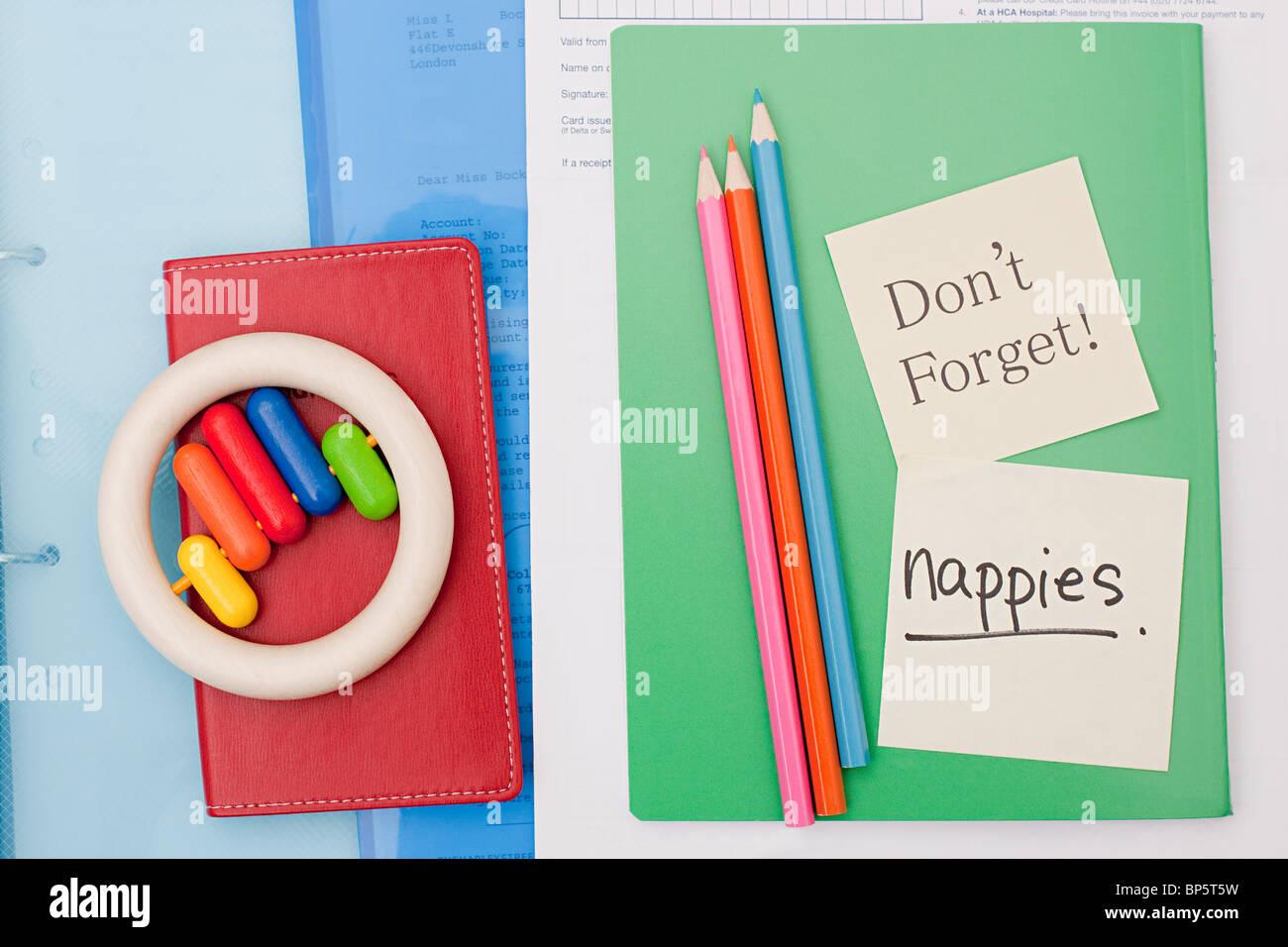 Les notes de rappel sur l'ordinateur portable de parent Photo Stock