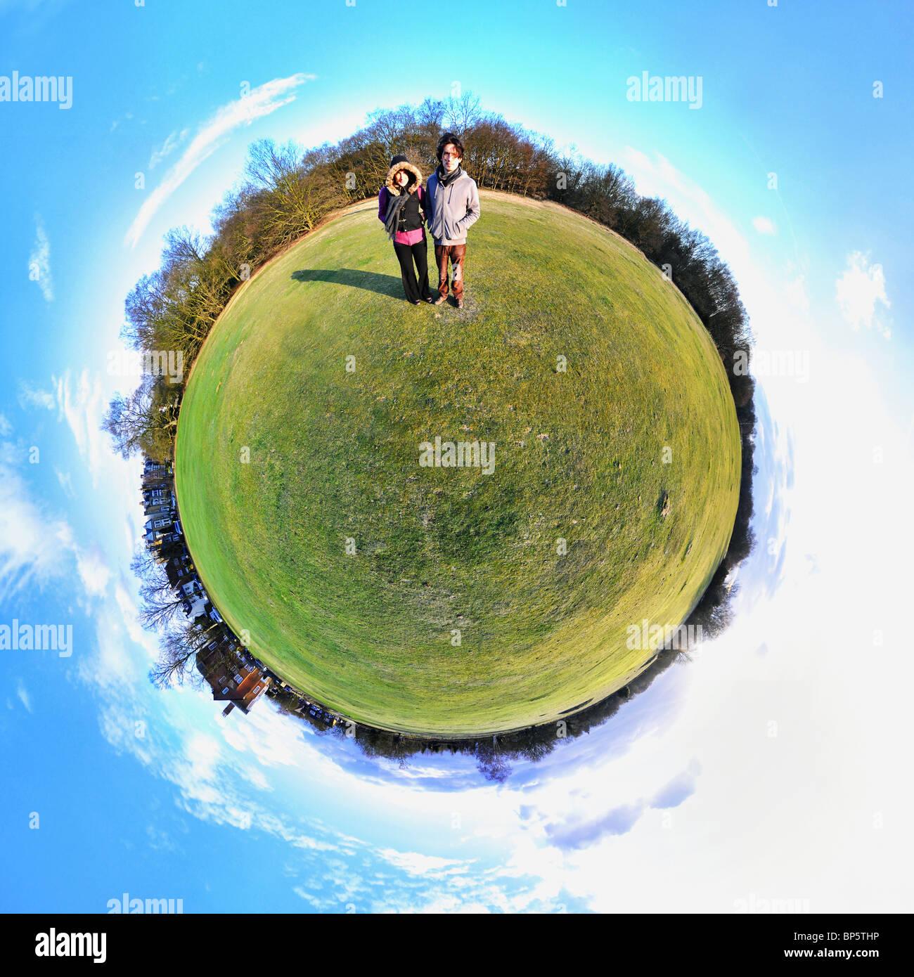 Personnes dans parc avec peu d'effet de la planète Photo Stock