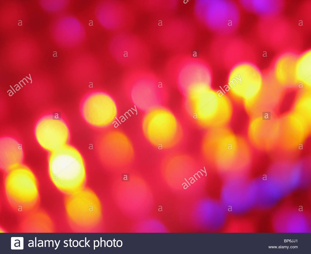 Une image abstraite de violet, rose et jaune s'allume Photo Stock
