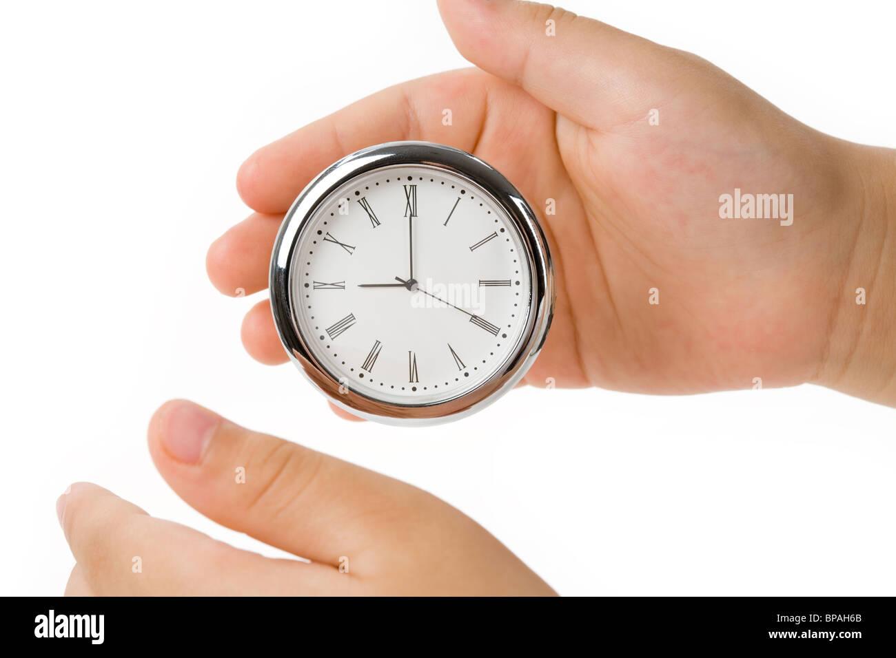 Horloge et doigt, notion du temps le contrôle et l'équilibre Photo Stock