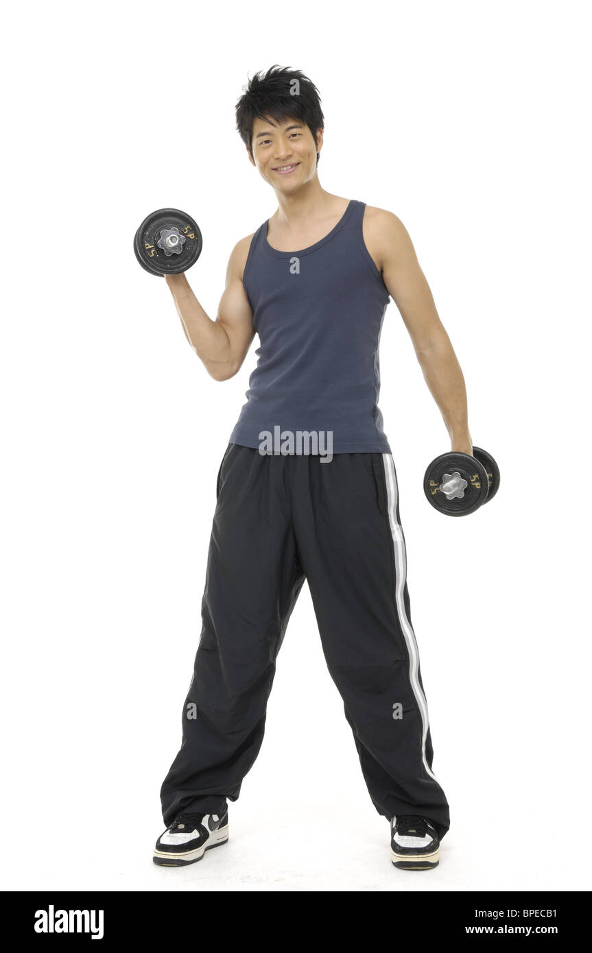 Young man exercising with dumbbells Photo Stock