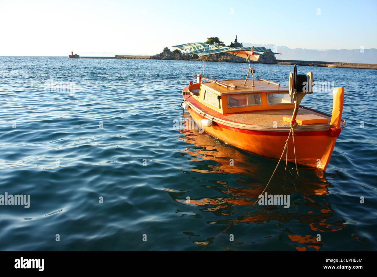 Bateau sur la mer d'Orange Photo Stock