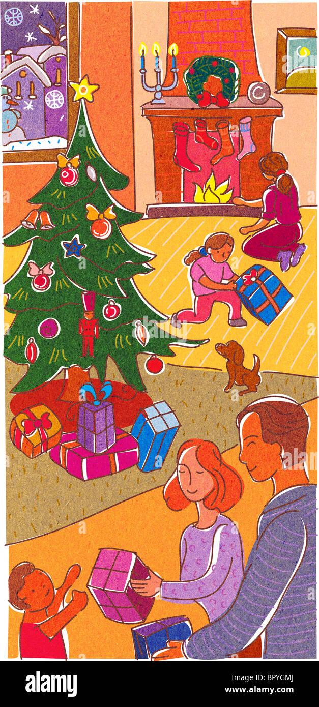 Une famille présente l'ouverture le jour de Noël Banque D'Images