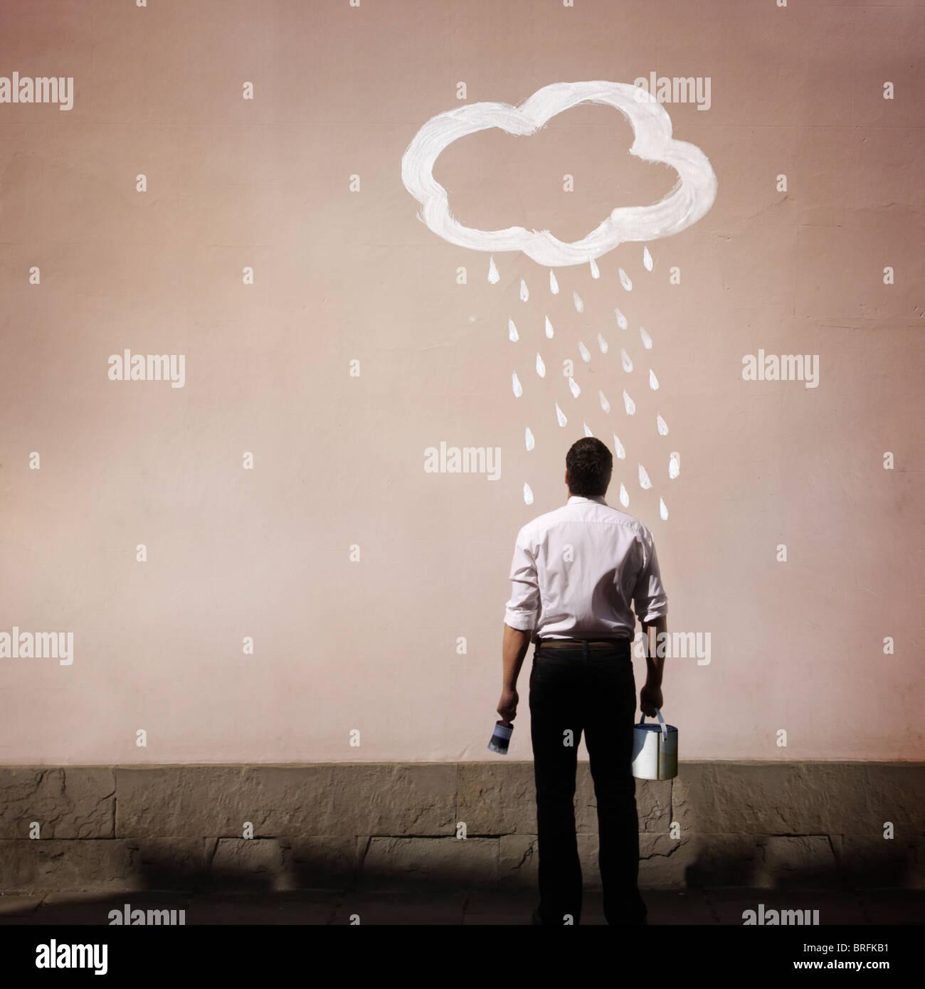 Man with rain cloud peint sur un mur Photo Stock