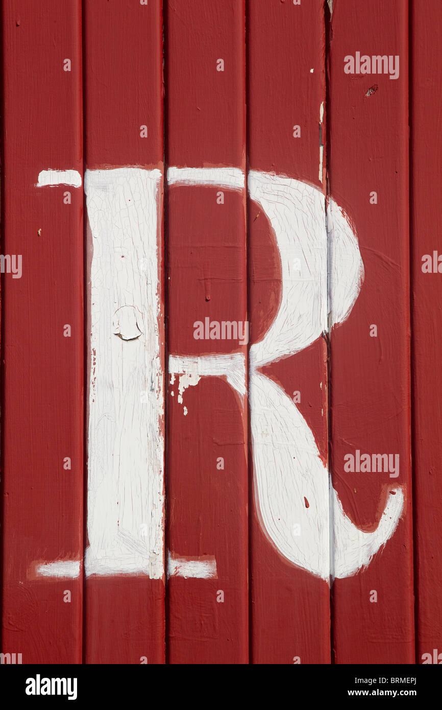 La lettre R, blanc sur rouge boards Photo Stock