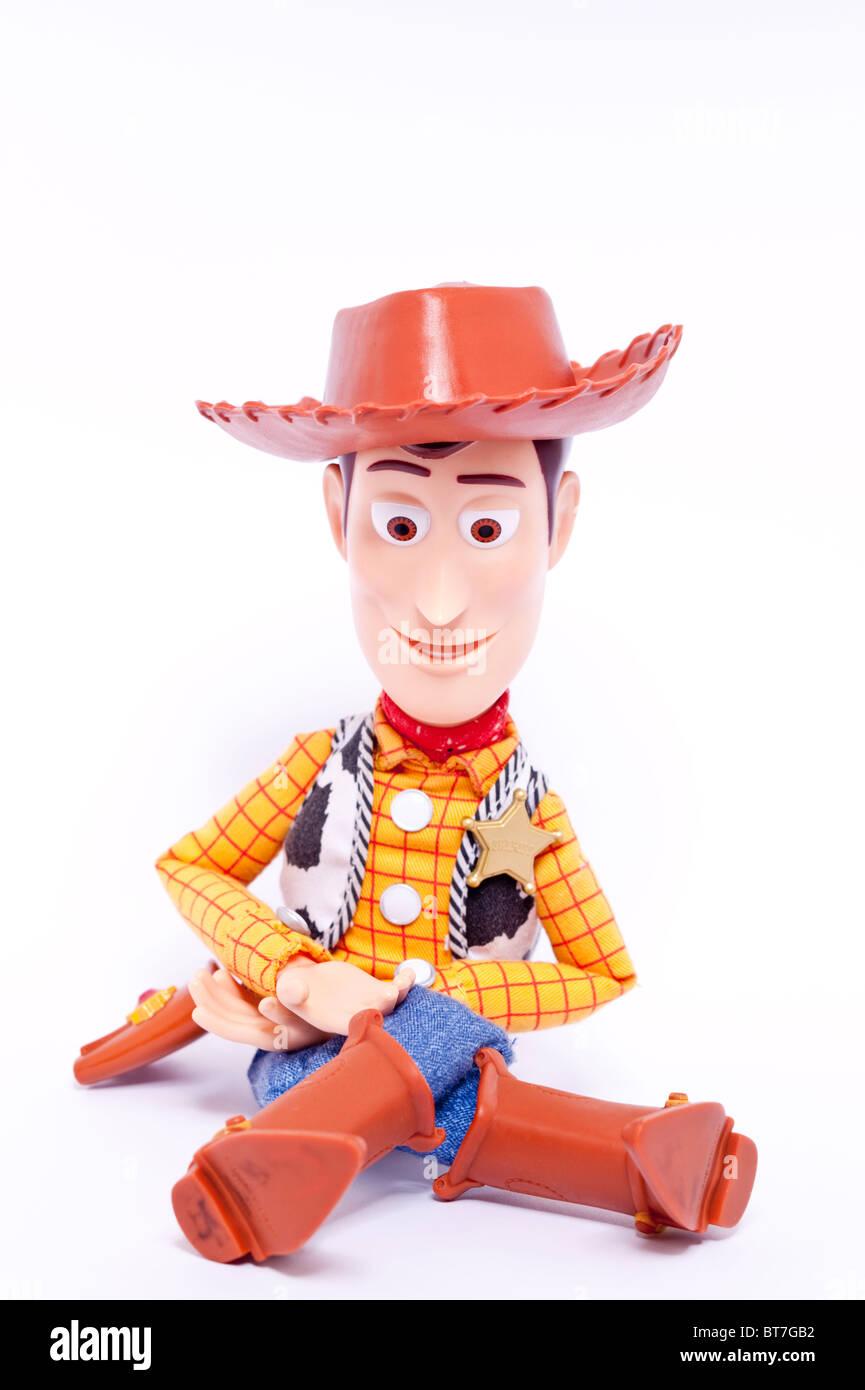 Une photo d'un jouet d'enfant du caractère boisé films Toy Story sur un fond blanc. Photo Stock