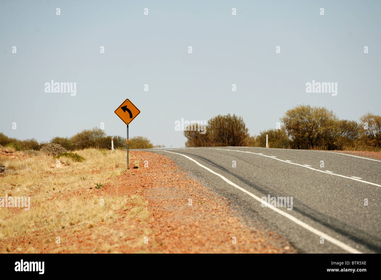 L'Australie, Courbe road sign Photo Stock