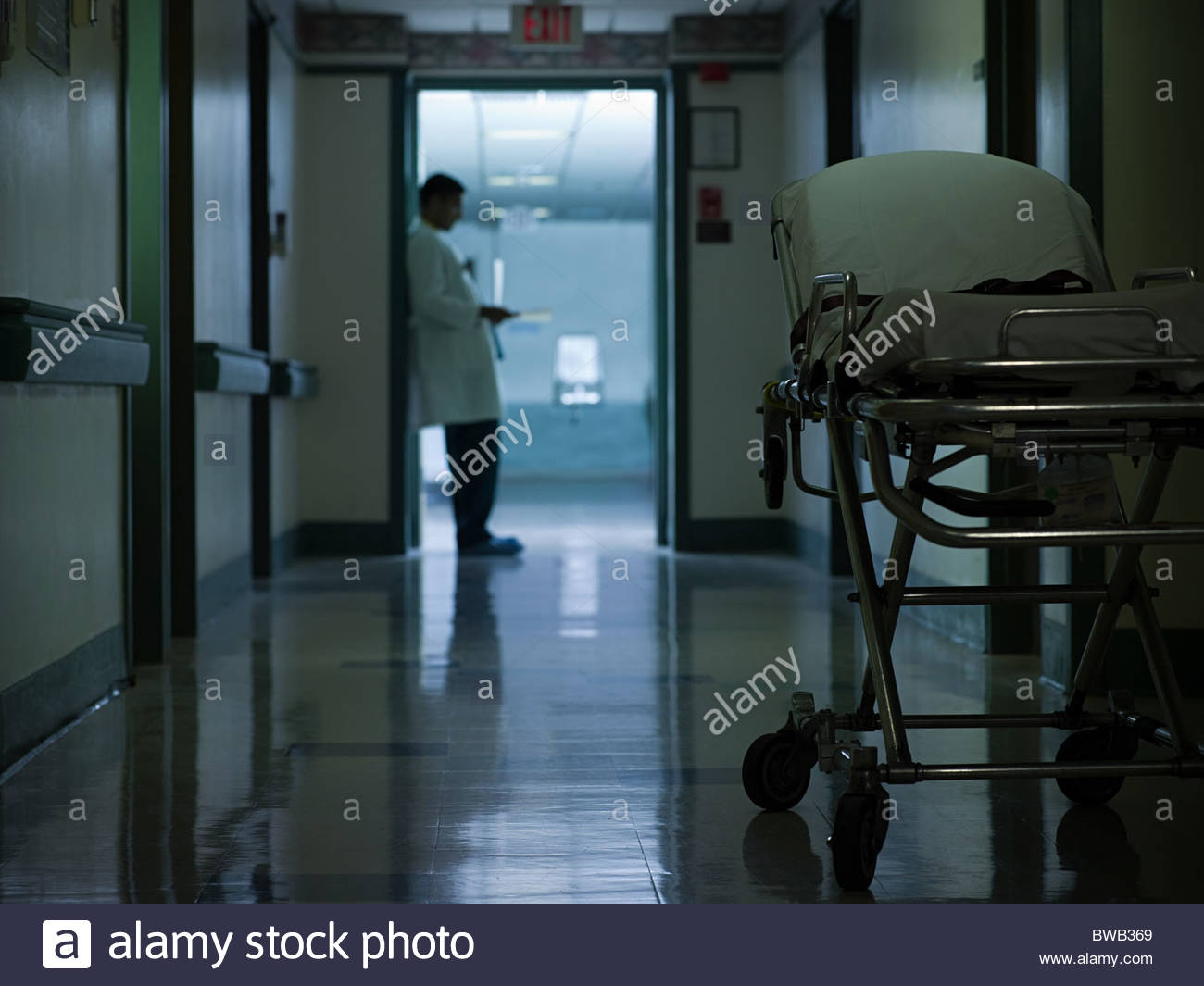 Male doctor in hospital corridor Photo Stock