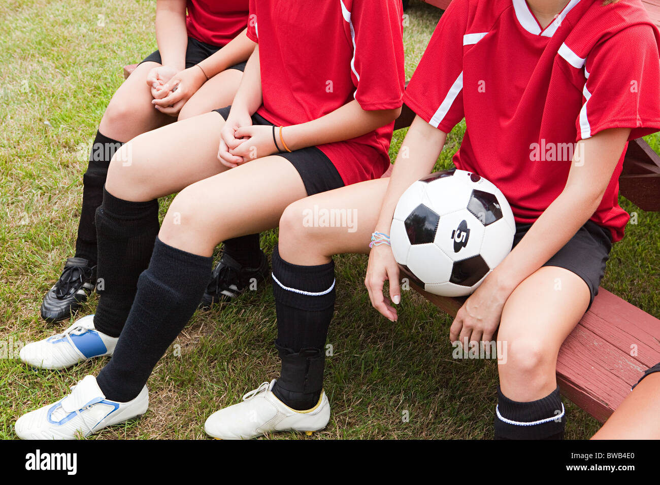 Cropped shot of girl soccer players Photo Stock