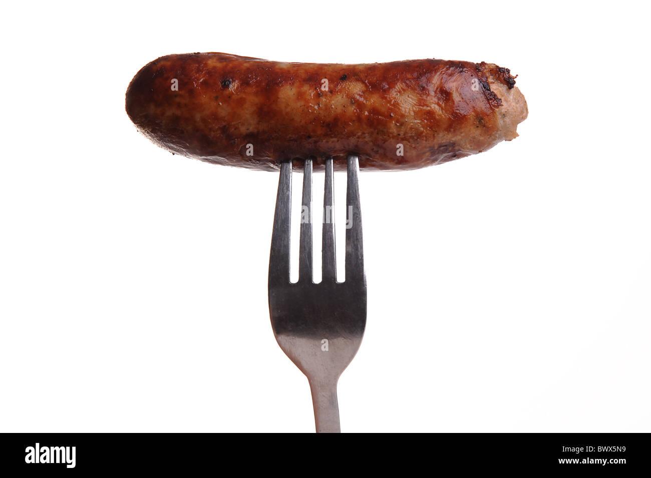 Sur une fourchette de saucisse Photo Stock