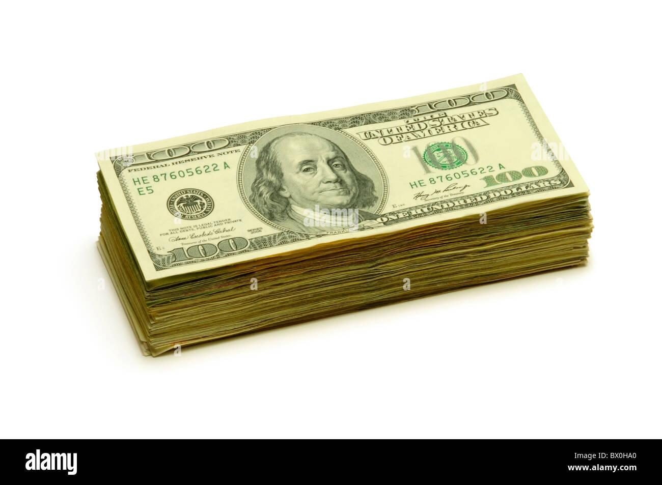 Pile de billets de 100 $ sur une surface blanche Banque D'Images