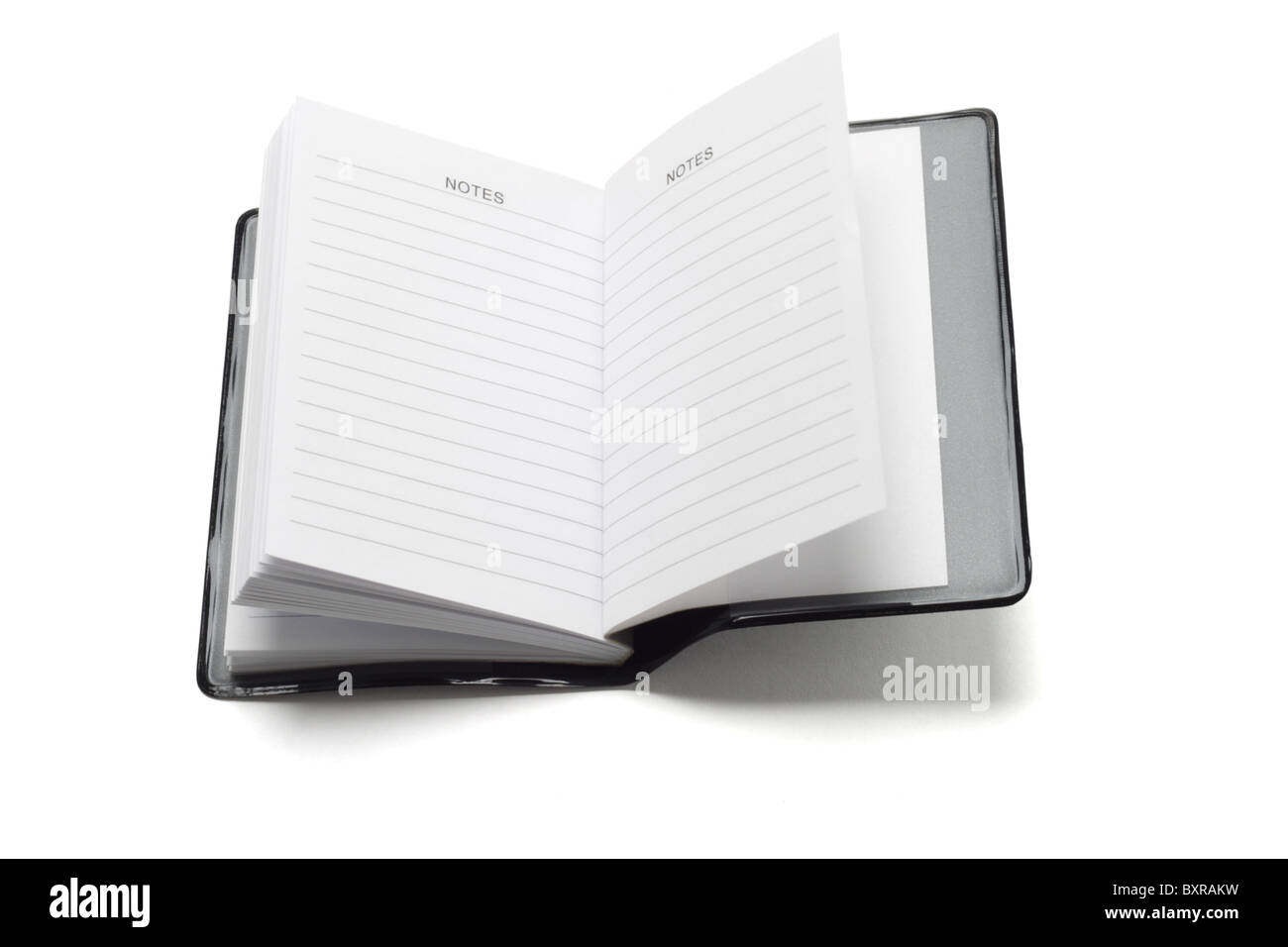 Note pocket mini livre sur fond blanc Photo Stock