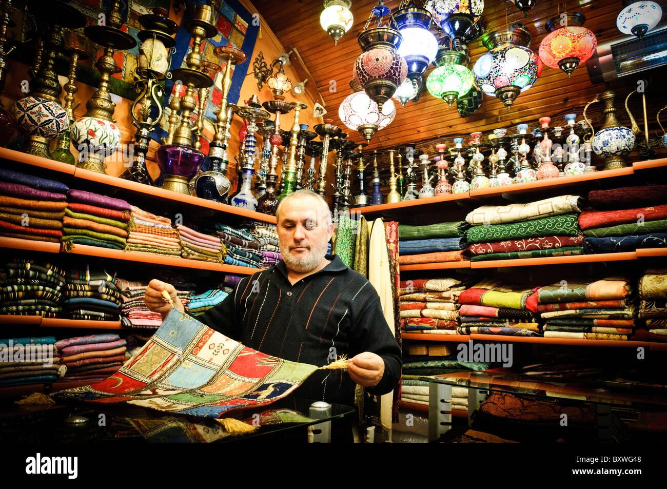 162c991f2c5b Le vendeur présente certains de ses foulards en soie dans son magasin à  l Arastar