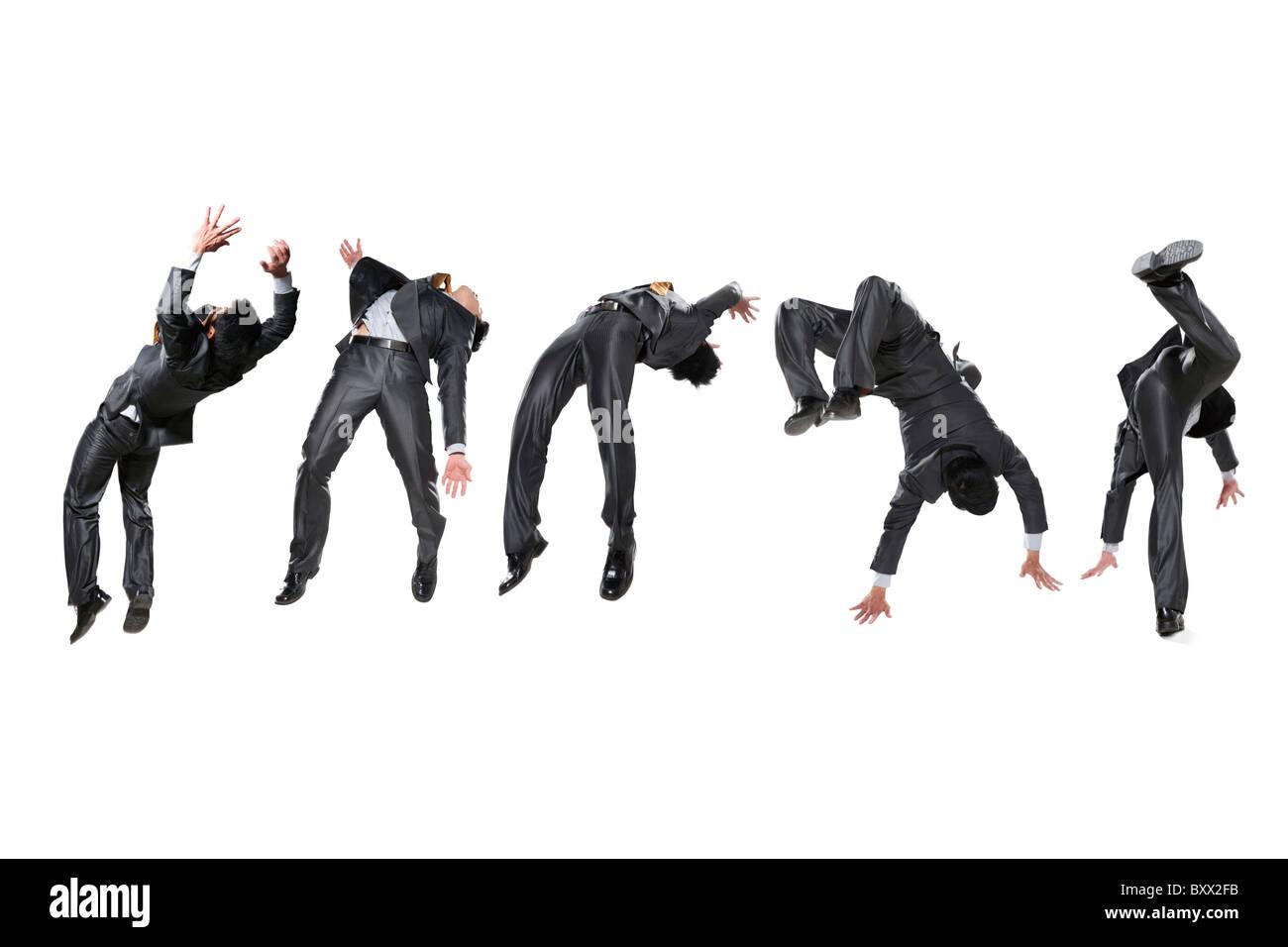 Cinq hommes d'inversion dans l'air Photo Stock