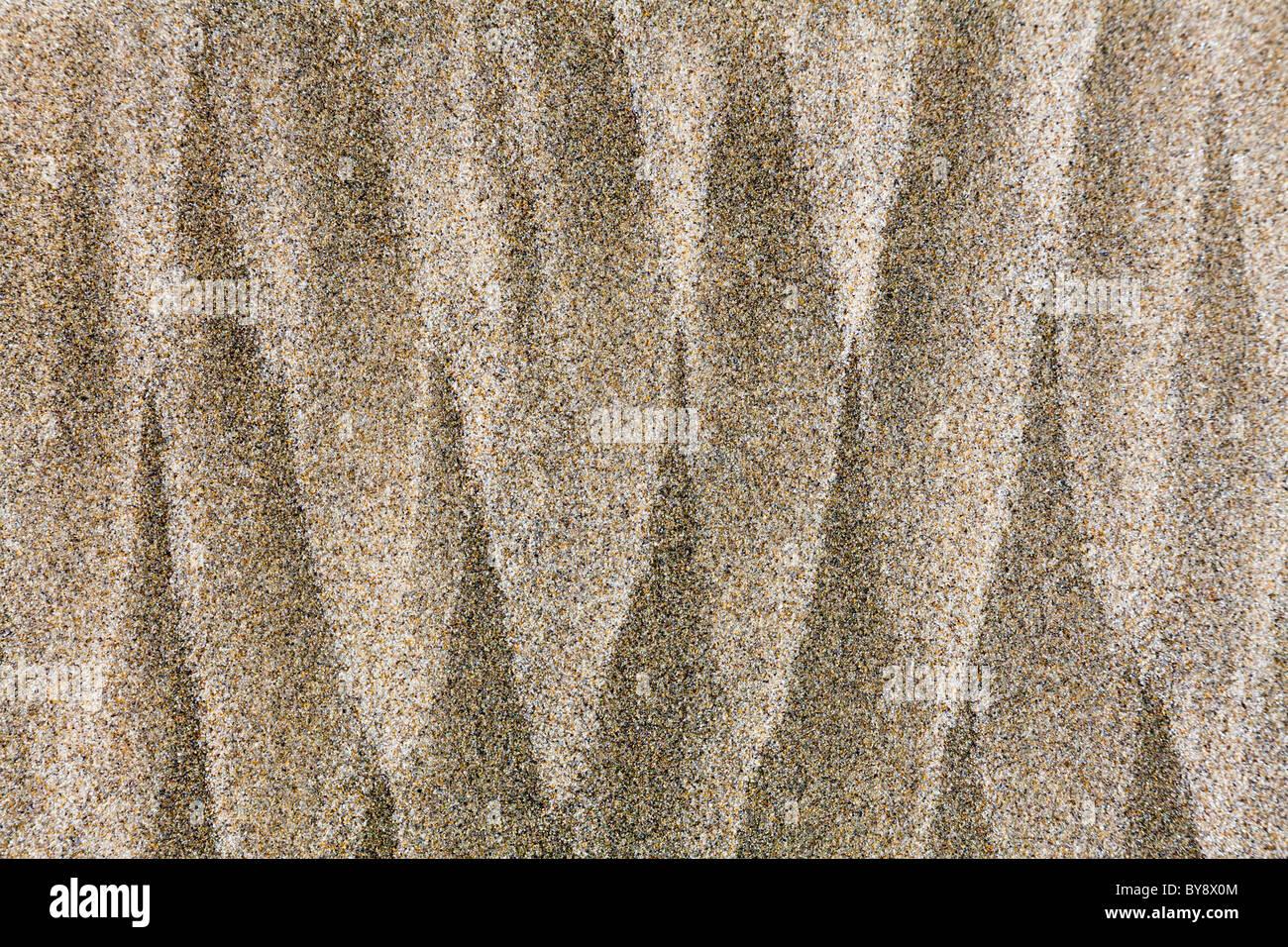 USA; côte de l'Oregon; Devil's Punchbowl State Natural Area; les modèles dans le sable de la plage Banque D'Images