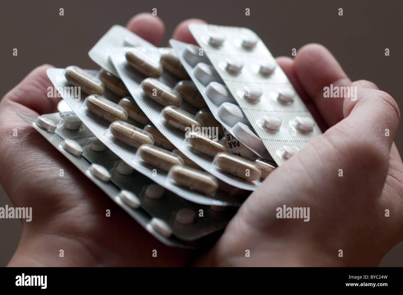 Hands holding prescription pills Photo Stock