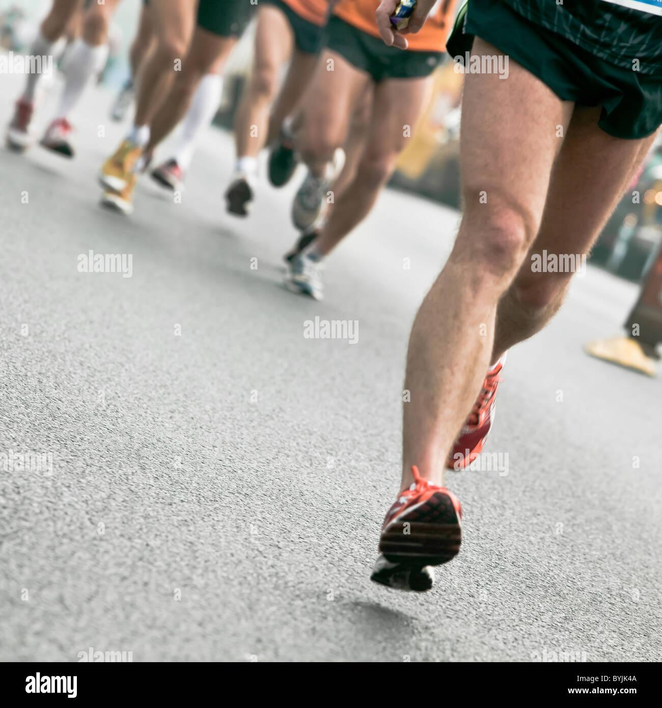 Man running in city marathon Photo Stock