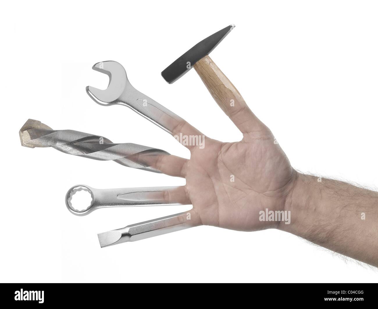 Homme à main pleine d'outils sur fond blanc Photo Stock
