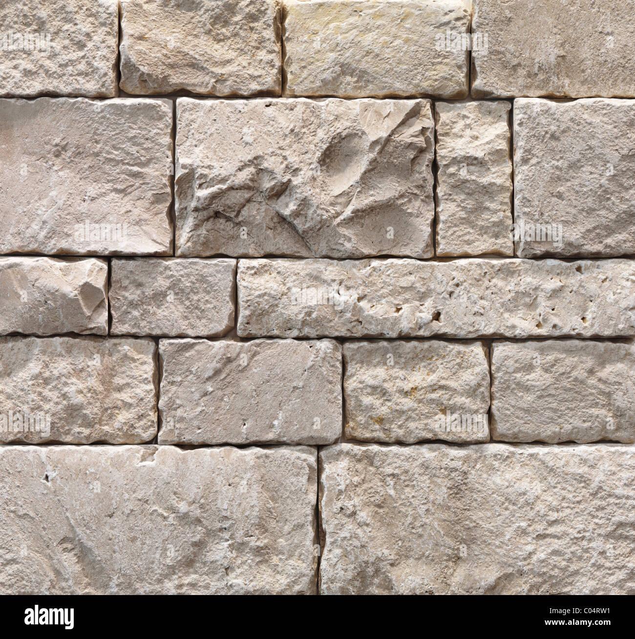 Durango splitface ivoire 600x600 texture background. Finition en pierre extérieur Photo Stock