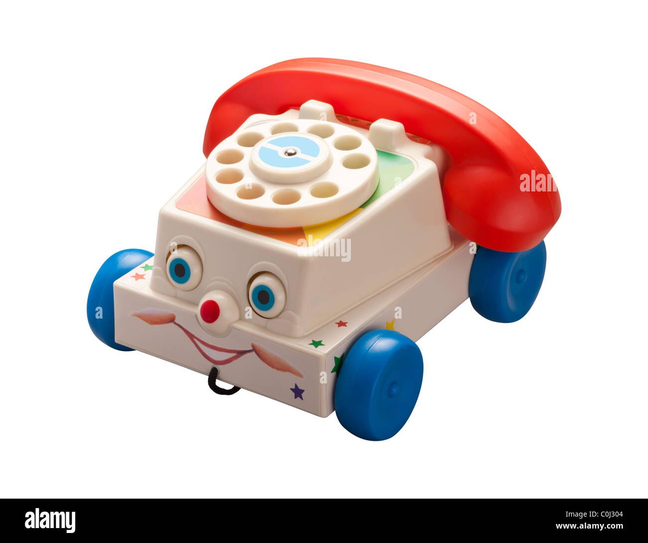 Téléphone jouets anciens isolé sur un fond blanc. Photo Stock