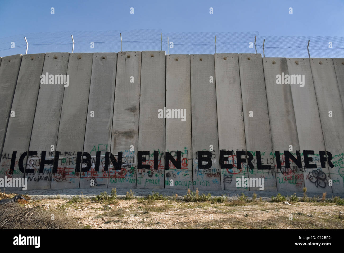 Un graffiti sur le mur de séparation, la Palestine Photo Stock