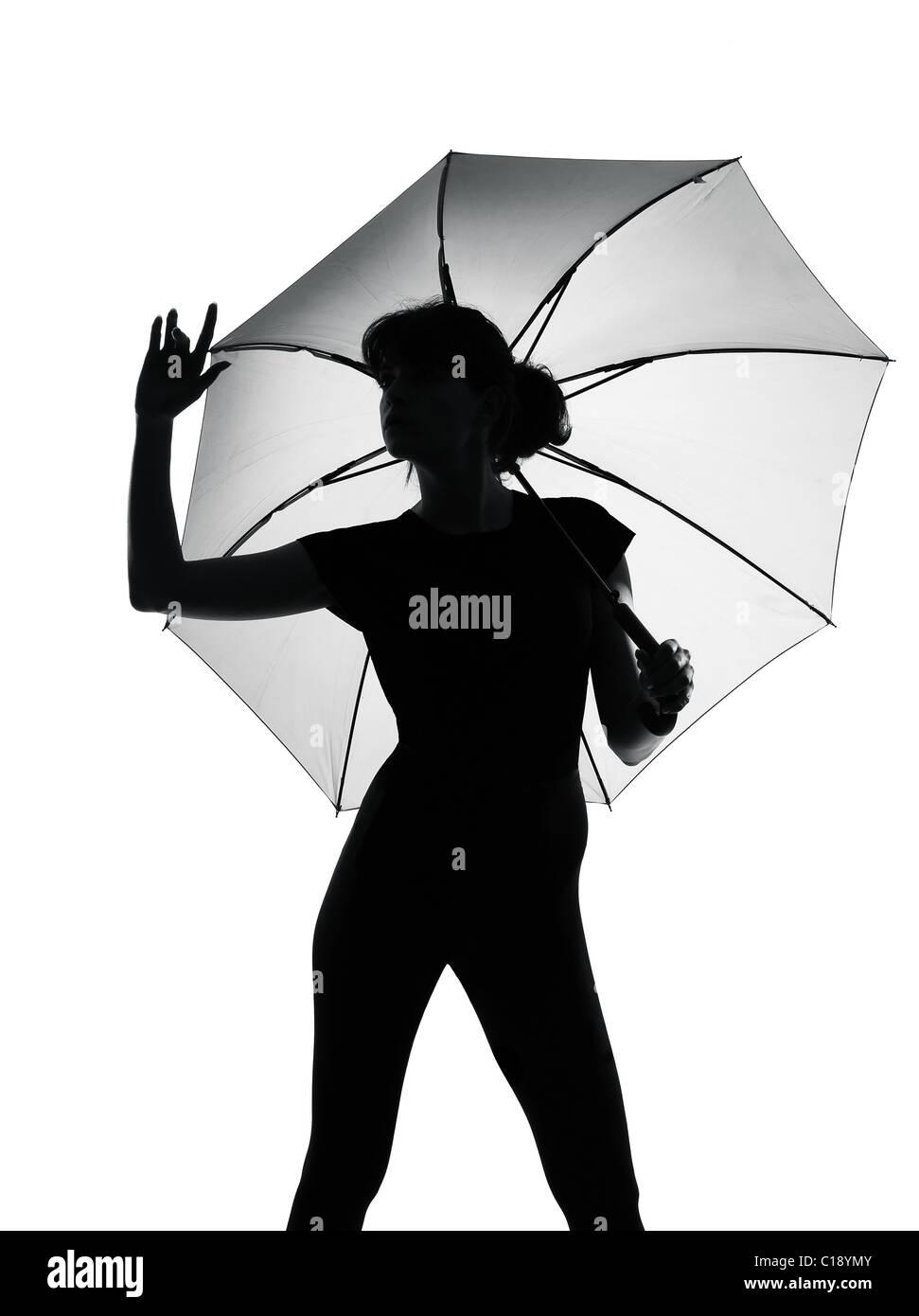Silhouette pleine longueur dans l'ombre d'une jeune femme avec parapluie ouvert dans Studio isolé sur Photo Stock