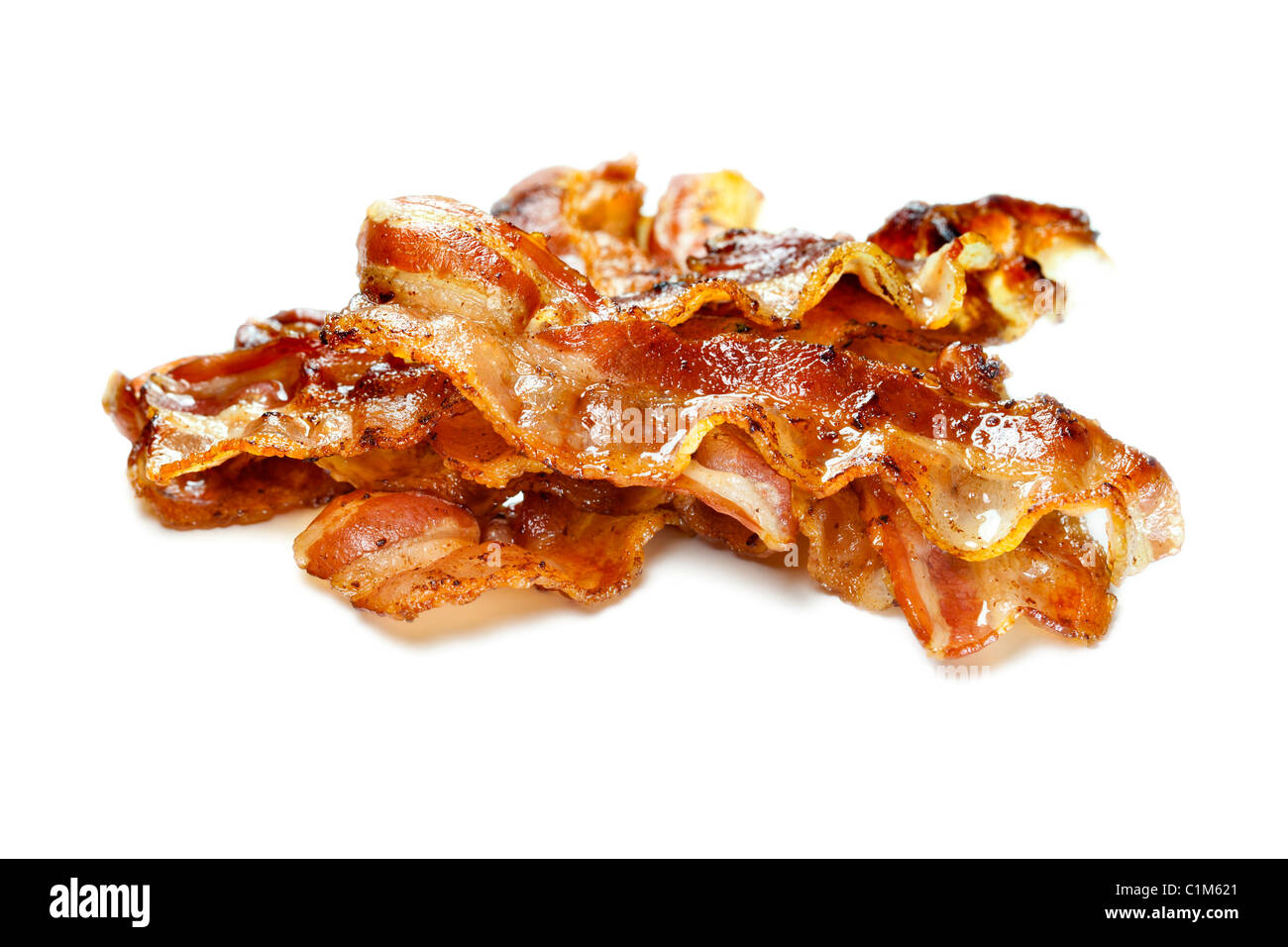Bacon cuit isolé sur fond blanc. Charles Lupica Photo Stock