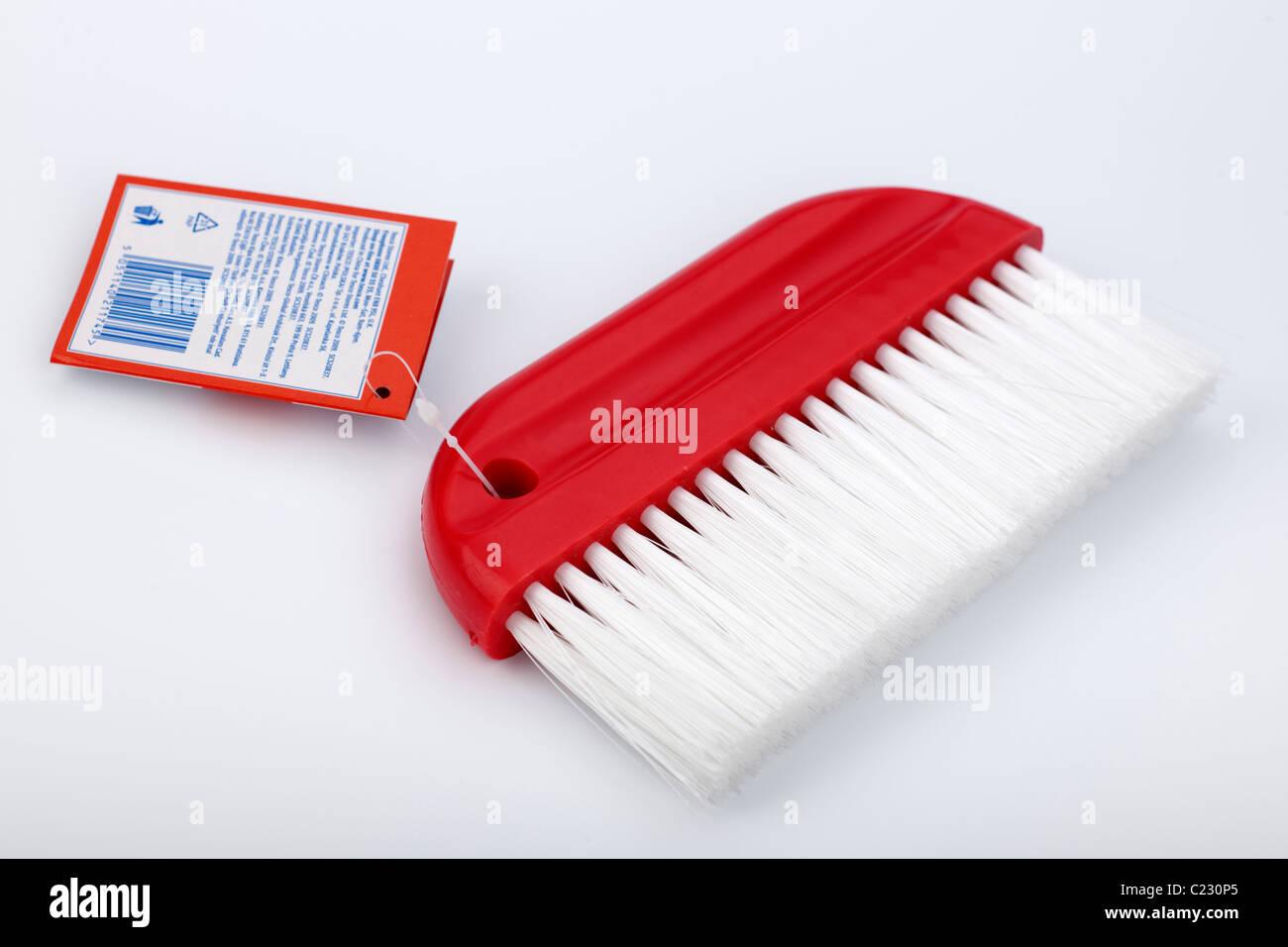 Papier peint rouge et étiquette de brosse de lissage Banque D'Images